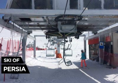 Skier going up the slope with one the 2 chairlift at Tochal