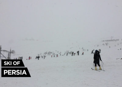 Skiing in a foggy weather at Chelgerd ski resort, Iran