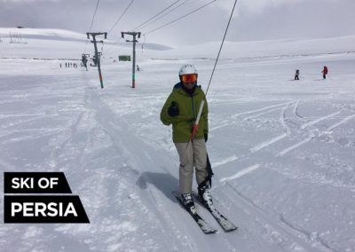 Skier going up with the ski-lift in Sahand, Iran