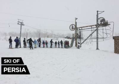 Ski-lift under a heavy snowfall in Chelgerd, Iran