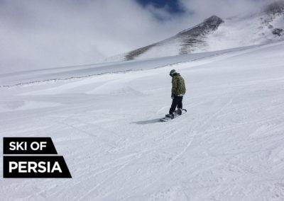 Snowboader going down the slope in Sahand ski resort